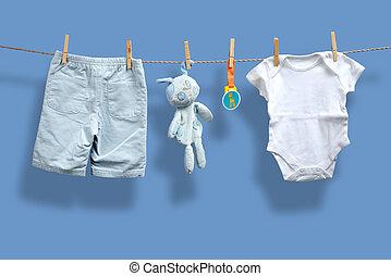 baby- junge, wäscheleine, kleidung