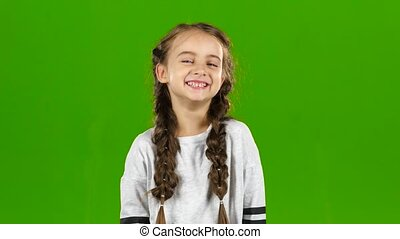 Baby laughs gaily. Green screen - Baby laughs giggly in the...