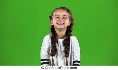Baby laughs gaily. Green screen. Slow motion