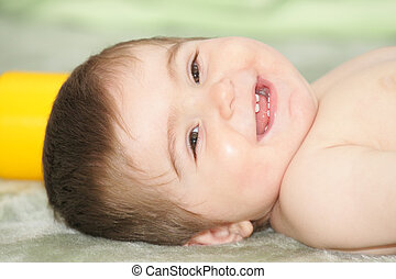 Baby laying down on rug - Smiling baby laying down on green ...