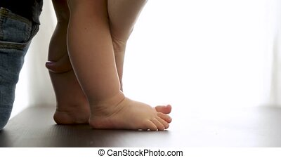 Baby learn to walk legs close up - Close-up legs shot of...