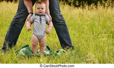 Baby learns to walk outdoors
