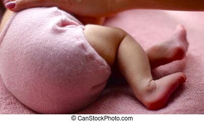 baby leg lying back
