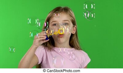 Baby lets the soap bubbles. Green screen - Baby girl lets...