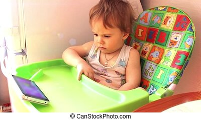 baby looking  cartoon on a smartphone