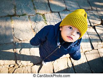 Baby looking up at the camera