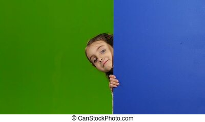 Baby looks out from behind an empty board. Green screen -...