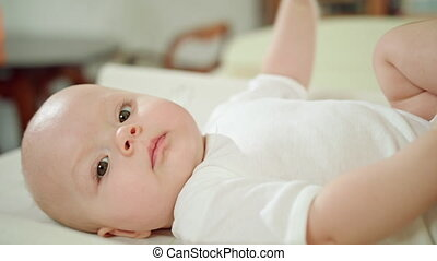 Baby Lying in Bed at Home