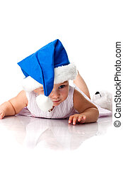 Baby lying in Santa's blue hat