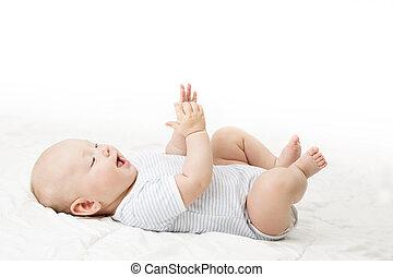 Baby Lying on Back, Happy Infant Kid in Blue Bodysuit, Beautiful Child Lie on White blanket