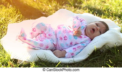 Baby lying on the grass