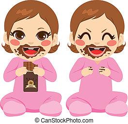 baby meisje, het eten van chocolade