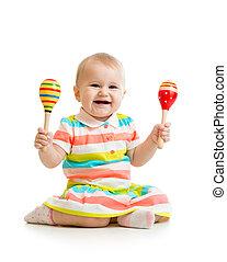 baby meisje, spelend, met, muzikalisch, toys., vrijstaand, op wit, achtergrond