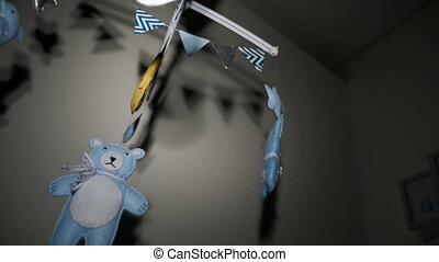 baby mobile with blue hand-stitched animal and bird toys with yellow moon