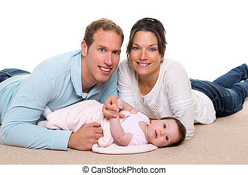 Baby mother and father happy family lying on carpet - Baby...