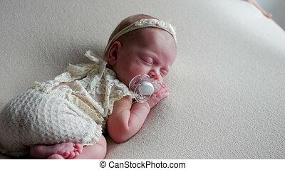 baby newborn girl sleeping sweetly