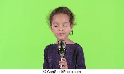 Baby of an african american girl singing in a retro...