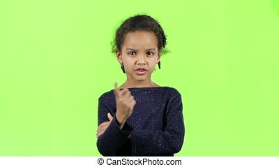 Baby of an african american is angry. Green screen. Slow...