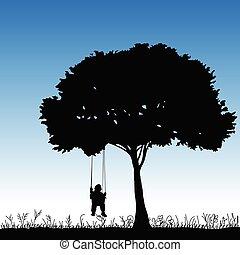 baby on a swing is swinging in a tree