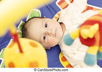 Baby on activity mat