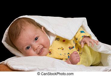 Baby on blanket over black