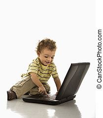Baby on computer.