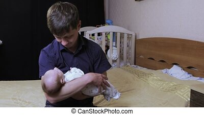 Baby on father's hands - Dad makes a massage for the child...
