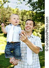 baby on father's hands