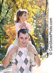 baby on father`s shoulders