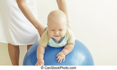 Baby on fitness ball