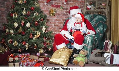 Baby on the lap of Santa on Christmas Eve