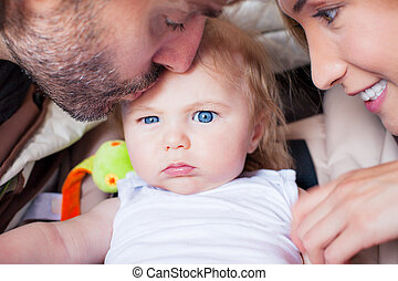 baby parents family attention frowning