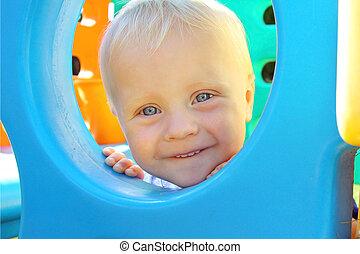 Baby Peeking at Playground