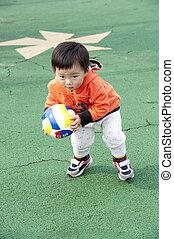 baby play in a children's playground