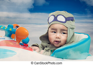 Baby play on airplane toy on the sky