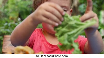 Baby played with green salad - Small child nature table...
