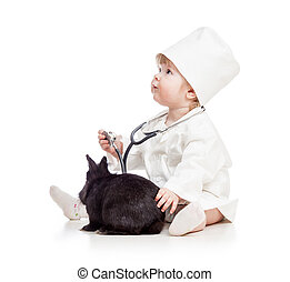 Baby playing doctor with pet bunny