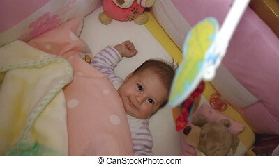 Baby playing in crib