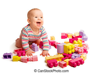 baby playing in designer toy blocks