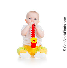 baby playing musical toy isolated