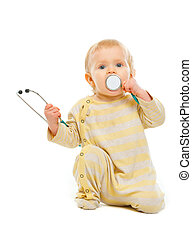Baby playing stethoscope isolated on white