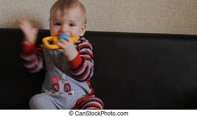 baby playing with a rattle