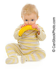 Baby playing with banana isolated on white