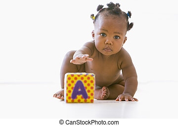 Baby playing with block