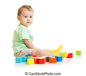 baby playing with colorful blocks isolated