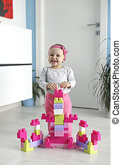 baby playing with colorful toy blocks