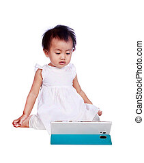 baby playing with digital tablet isolated on white background