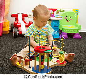 Baby Playing With The Toys - Cute baby boy playing with the...