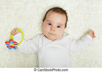 Baby playing with toys and discovery