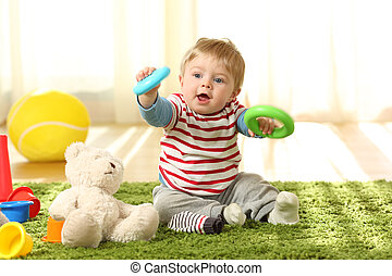Baby playing with toys on a carpet